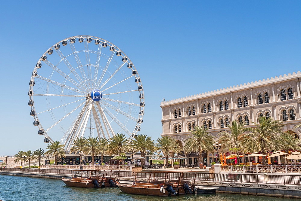 Eye of the Emirates and cafes in Sharjah, United Arab Emirates, Middle East