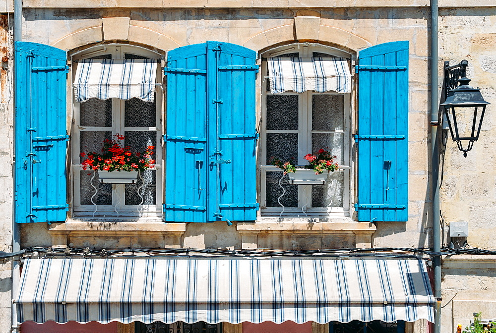 Traditional Provencal building facade in the historic centre of Arles, a city on the Rhone River in Provence, France, Europe