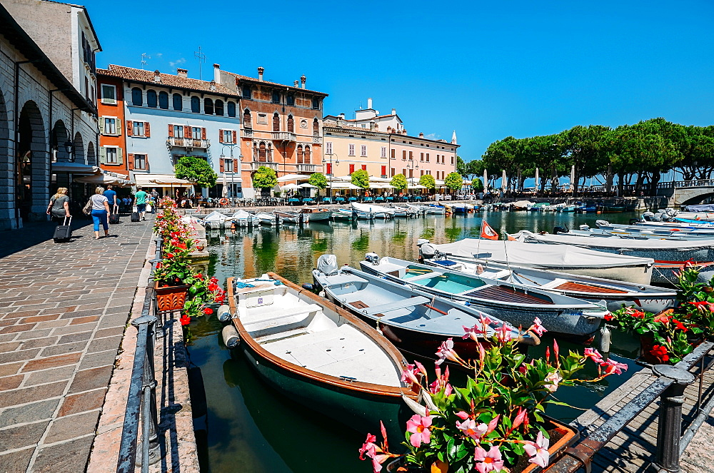 Boats on marina with tourists at cafes and restaurants at Desenzano del Garda, Lake Garda, Lombardy, Italian Lakes, Italy, Europe - 1243-293