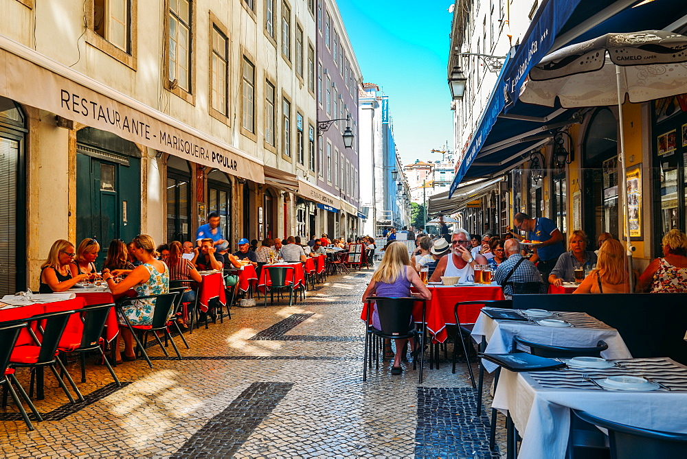 Busy outdoor terrace Portuguese restaurants at Rua da Prata catering to tourists, Lisbon, Portugal, Europe - 1243-329