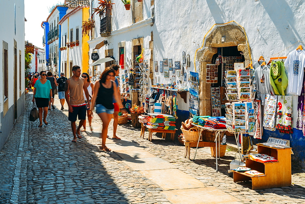 Tourists and shops in the typical alleys of the ancient fortified village of Obidos, Oeste Leiria District, Portugal, Europe - 1243-345