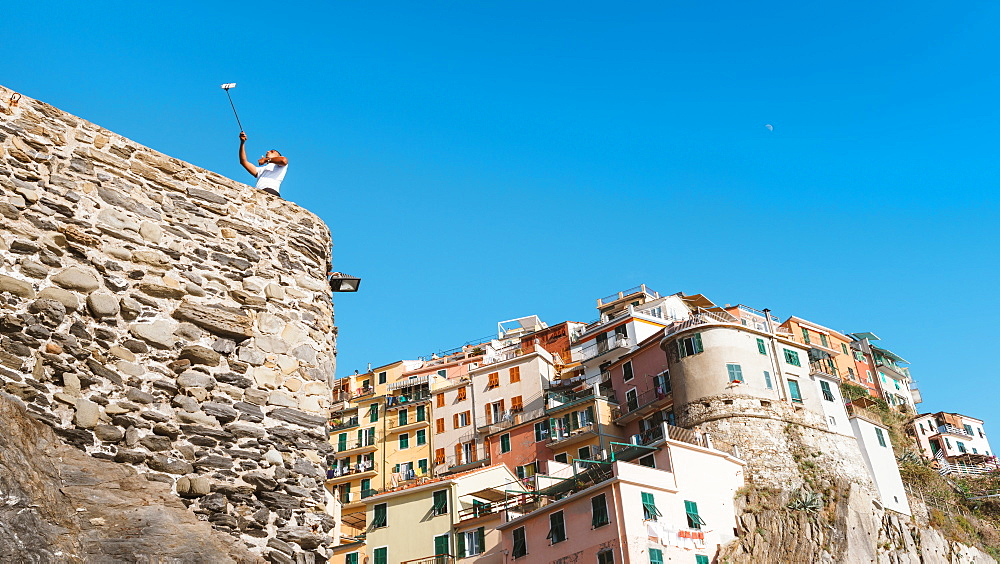 A man taking a selfie at Manarola, Cinque Terre, Italy - 1243-38