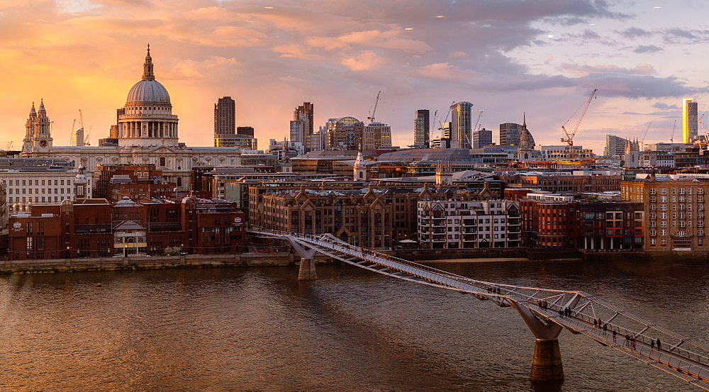 The view of the City of London from Tate Modern with the Millennium Bridge over the River Thames, and St. Paul's Cathedral, London, England, United Kingdom, Europe