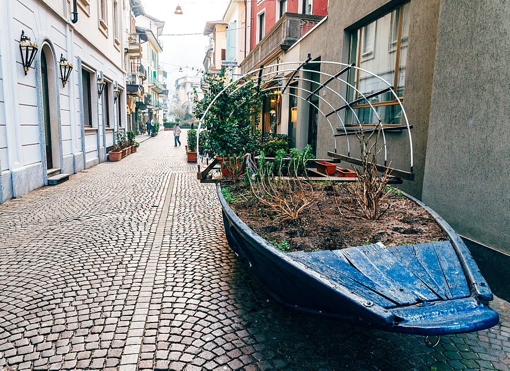 A boat filled with plants on a street in Stresa, Italy - 1243-52