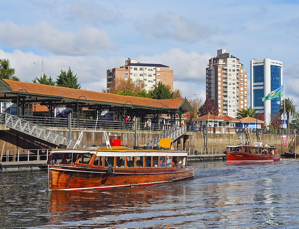 Vintage mahogany motorboats by the Fluvial Station on the Tigre River Canal, Tigre, Buenos Aires Province, Argentina, South America