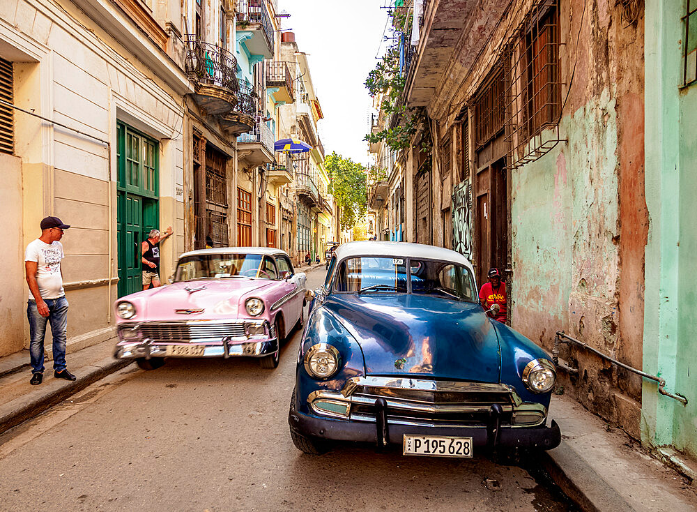 Vintage cars in the street of La Habana Vieja, Havana, La Habana Province, Cuba, West Indies, Caribbean, Central America