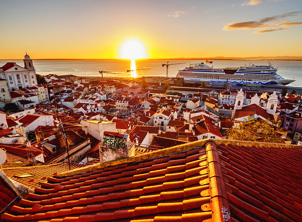 Miradouro das Portas do Sol, view over Alfama Neighbourhood towards the Tagus River at sunrise, Lisbon, Portugal, Europe