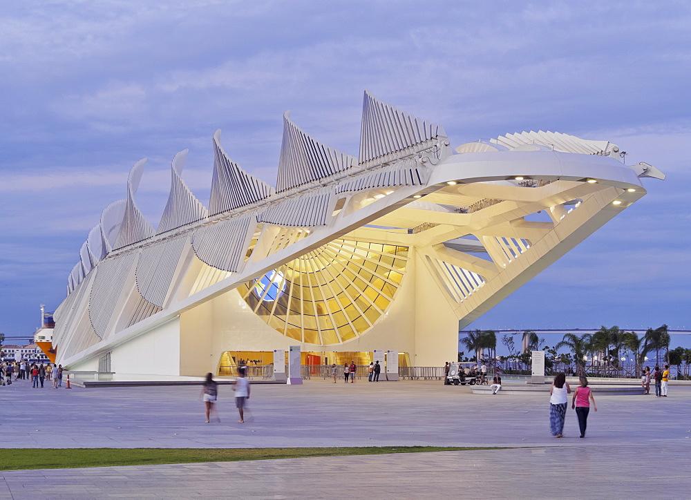 Twilight view of the Museum of Tomorrow (Museu do Amanha) by Santiago Calatrava, Praca Maua, Rio de Janeiro, Brazil, South America