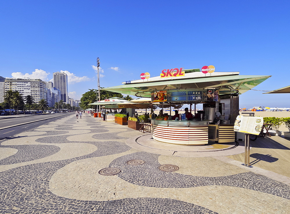 Portuguese wave pattern pavement and beach bar at Copacabana, Rio de Janeiro, Brazil, South America
