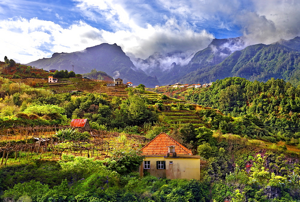 Elevated view of village and tree covered hills and mountains at Lameiros, near Sao Vicente, Madeira, Portugal, Atlantic, Europe