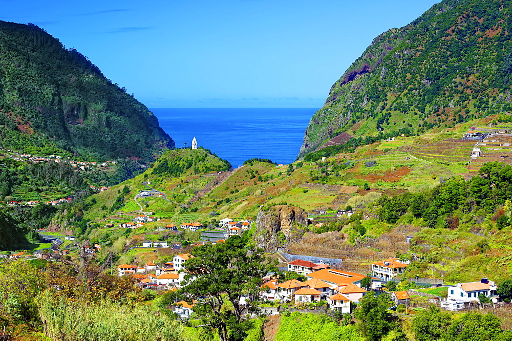 A distant view of Tower Chapel, Capela de Nossa Senhora de Fatima, looking towards Sao Vicente and the Atlantic Ocean, Madeira, Portugal, Atlantic, Europe - 1246-38