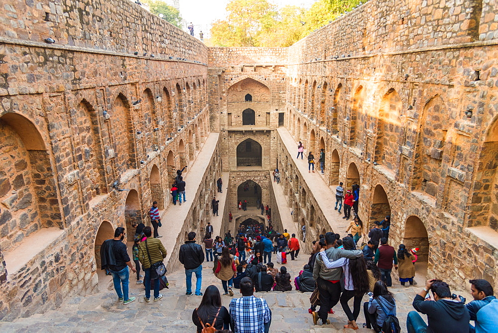 Groups of people at Agrasen ki Baoli, a historical step well on Hailey Road near Connaught Place, New Delhi, India, Asia