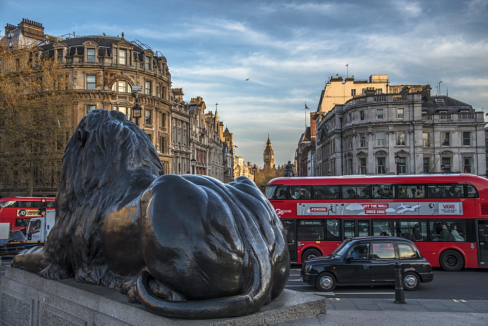 Landseer lion statue and double decker bus, London icons at Trafalgar Square, London, England, United Kingdom, Europe