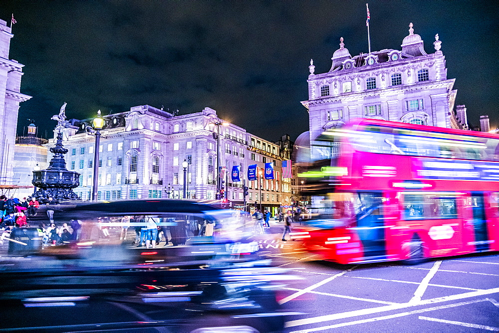 A bus and taxi zoom round Piccadilly Circus, London, England - 1247-85