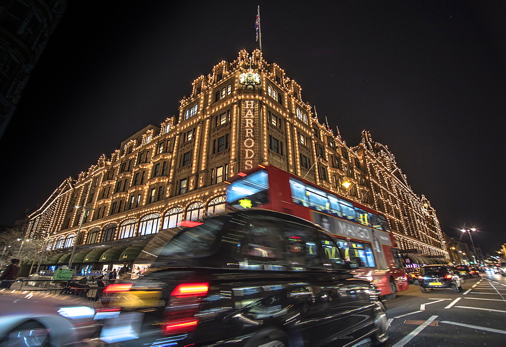 A London taxi and a London bus drive past Harrods, London, England, United Kingdom, Europe