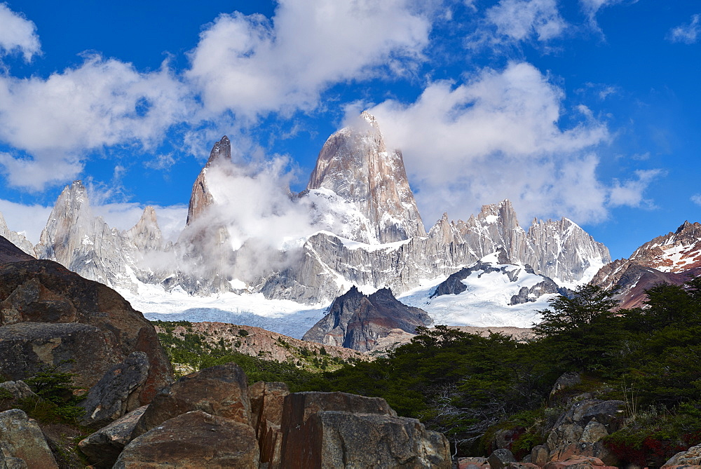 Monte Fitz Roy framed by rocks and trees near Arroyo del Salto in Patagonia, Argentina, South America