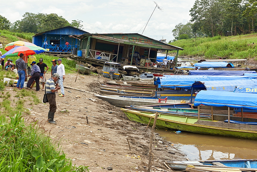 Locals at the port of Leticia, where boats leave for local communities in the rainforest, Leticia, Colombia, South America