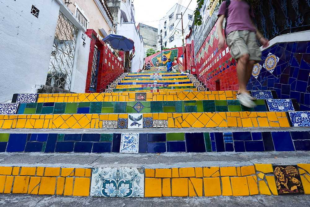 Motion blurred legs of man going down the Selaron Steps, 215 decorated steps the work of artist Jorge Selaron, Rio de Janeiro, Brazil, South America