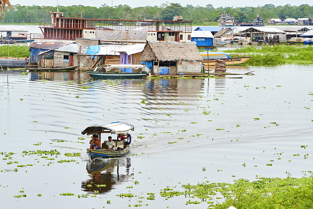 Riverboat in Nanay River with floating houses in the background, Iquitos, Peru, South America - 1248-53