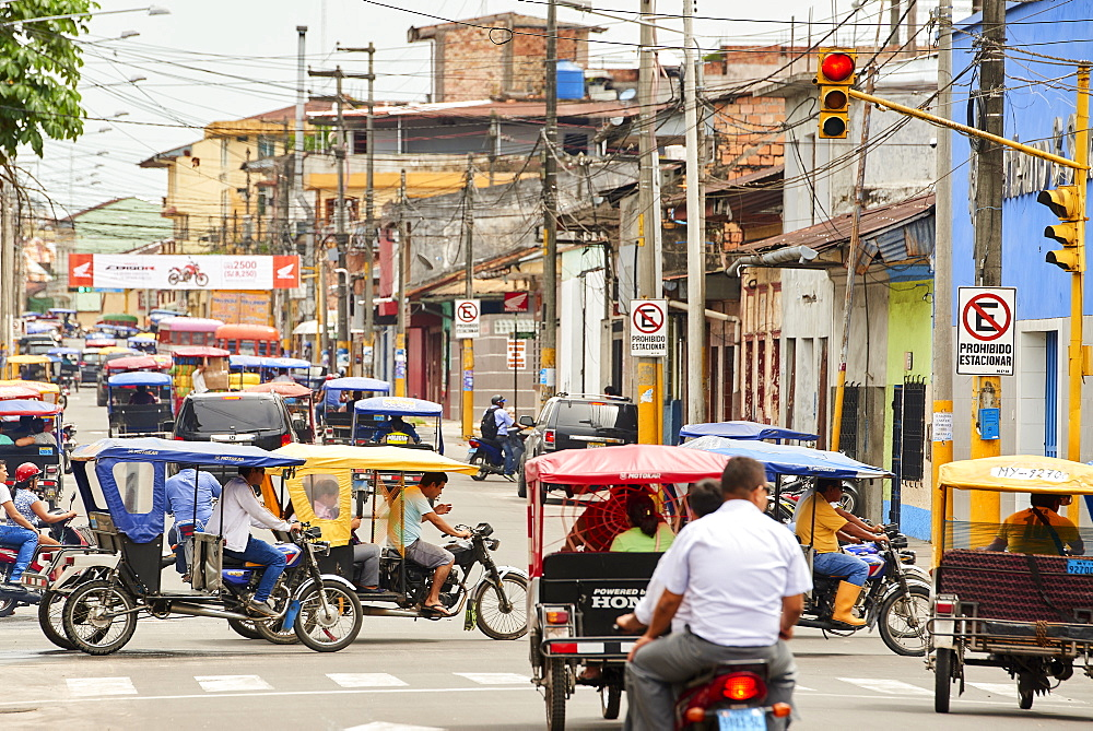 Mototaxis in a busy street in Iquitos, Peru, South America - 1248-54