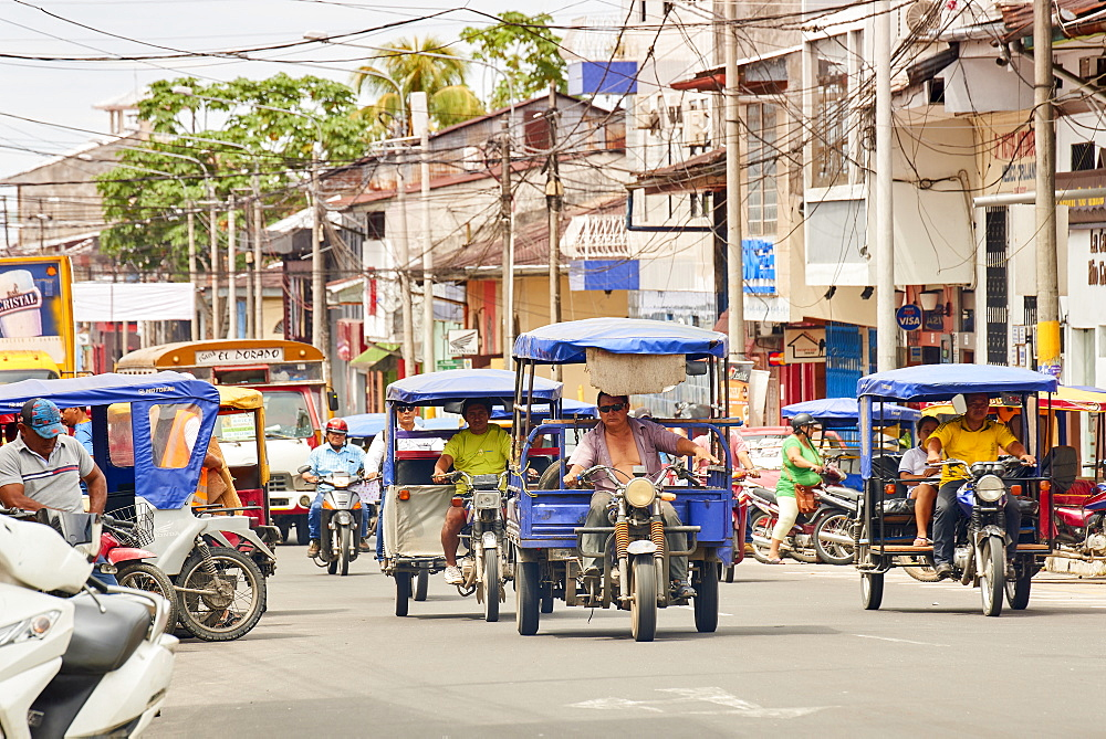 Mototaxis in a busy street in Iquitos, Peru, South America - 1248-56