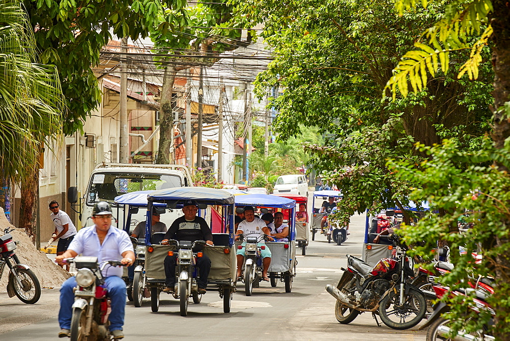 Mototaxis in a busy street in Iquitos, Peru, South America - 1248-59