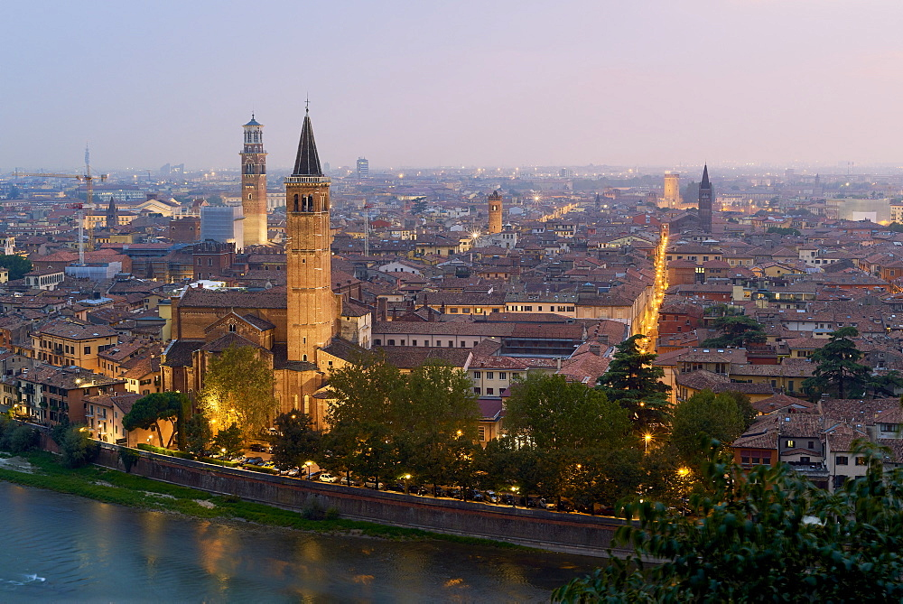 Verona cityscape at dusk seen from Castel San Pietro. The Italian city is the fictitious set for Shakespeare's Romeu and Juliet.