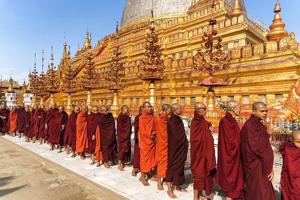 Monks at the Shwezigon Pagoda, Bagan (Pagan), Myanmar (Burma), Asia