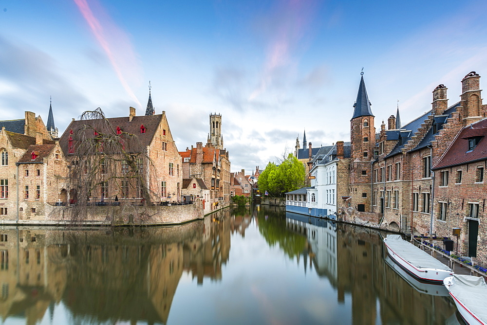 House reflections and boats on Dijver canal at dawn, Bruges, West Flanders province, Flemish region, Belgium, Europe