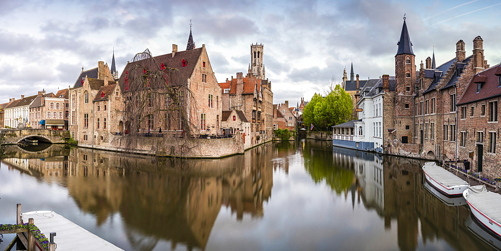 House reflections and boats on Dijver canal, Bruges, West Flanders province, Flemish region, Belgium, Europe