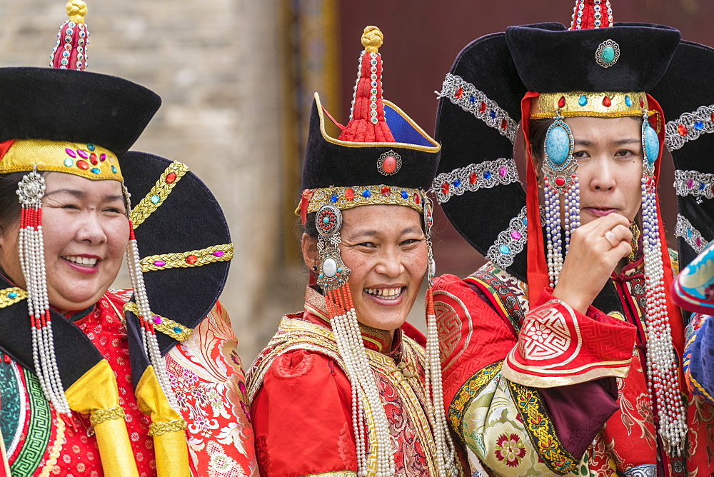 Three women wearing traditional Mongolian costumes. Harhorin, South Hangay province, Mongolia. - 1251-331