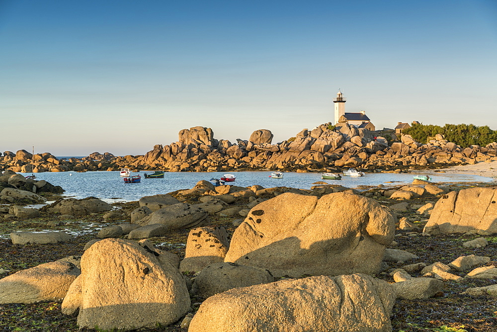 Boats and Pontusval lighthouse, Brignogan Plage, Finistere, Brittany, France, Europe