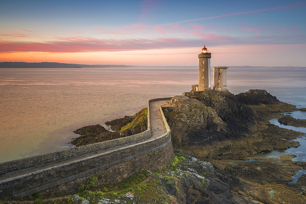 Sunset at lighthouse of Phare du Petit Minou in Finistere, Brittany, France, Europe
