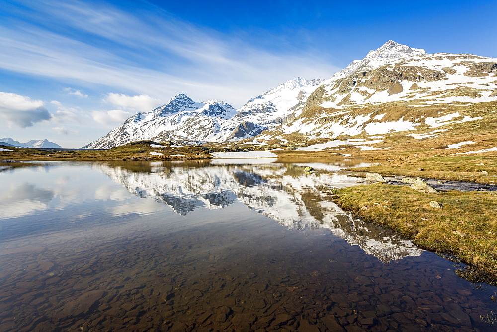 Last snow on the mountains above Lej Pitschen, Bernina Pass, Engadine, Switzerland, Europe