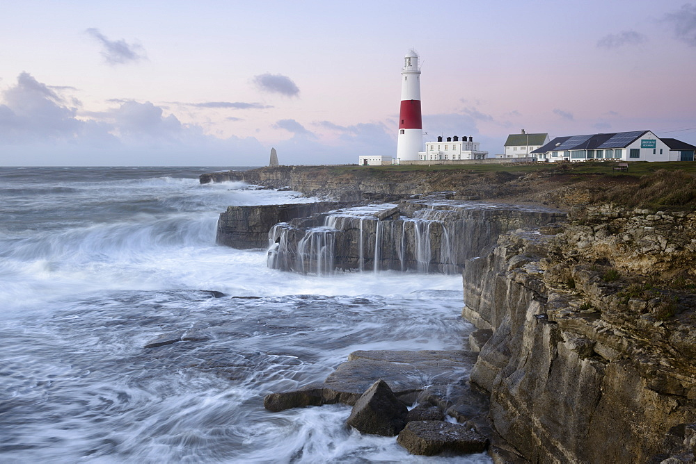 Rough seas crash over rocks near Portland Bill Lighthouse, Dorset, England, United Kingdom, Europe
