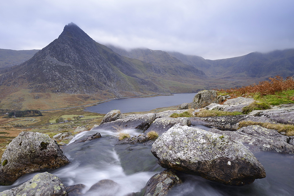 Water cascading down a fall on the Afon Lloer, overlooking the Ogwen Valley and Tryfan in the Glyderau mountain range, Snowdonia, Wales.