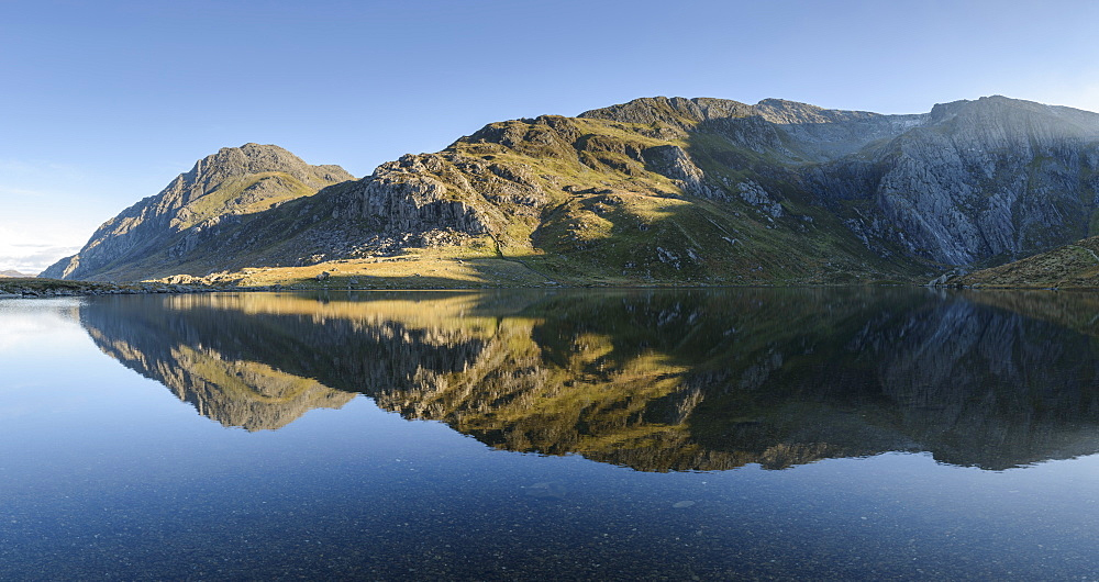 Tryfan reflected in the water of Llyn Idwal in Snowdonia, Wales, United Kingdom, Europe