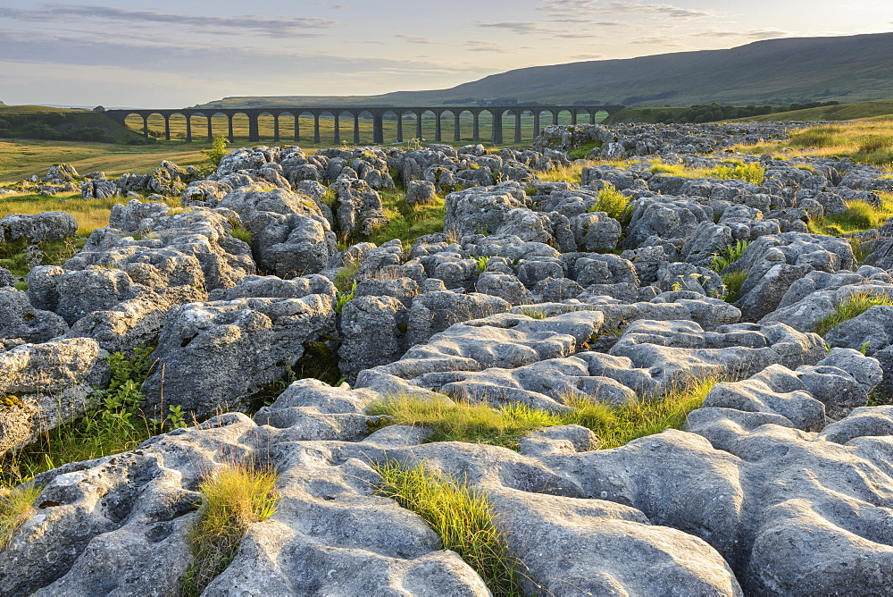 Limestone pavements and the Ribblehead Viaduct in the Yorkshire Dales, Yorkshire, England, United Kingdom, Europe