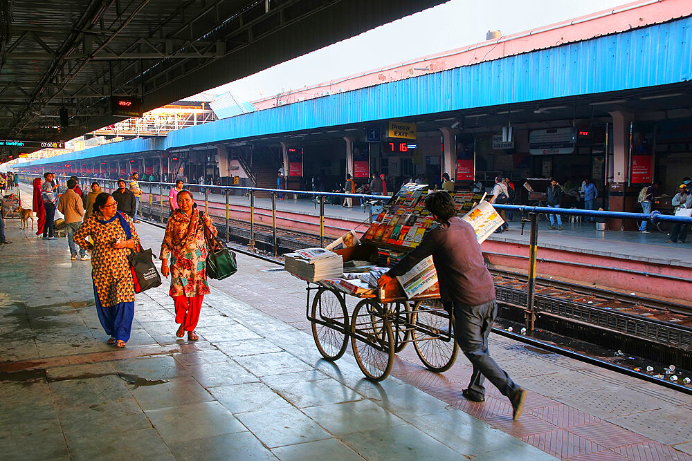 People walking at Jaipur Junction Railway Station in Rajasthan, India. Jaipur station deals with 35,000 passengers in a day.