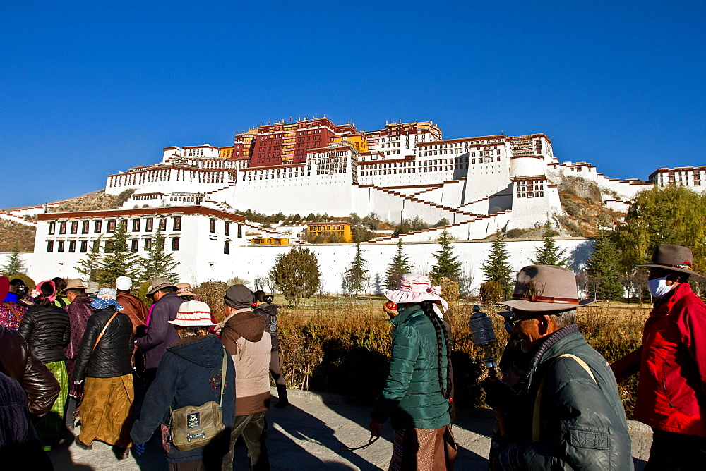 The Potala Palace, UNESCO World Heritage Site, with Tibetan Buddhist devotees, Lhasa, Tibet, China, Asia