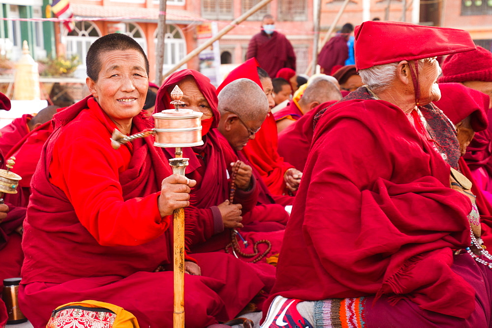 Tibetan Buddhist nun and prayer wheel, Boudhanath Stupa, Kathmandu, Nepal, Asia