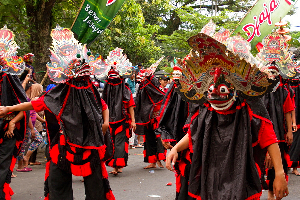 Indonesian men in masks taking part in a carnival celebrating Malang's 101st year anniversary, Malang, East Java, Indonesia, Southeast Asia, Asia - 1262-151