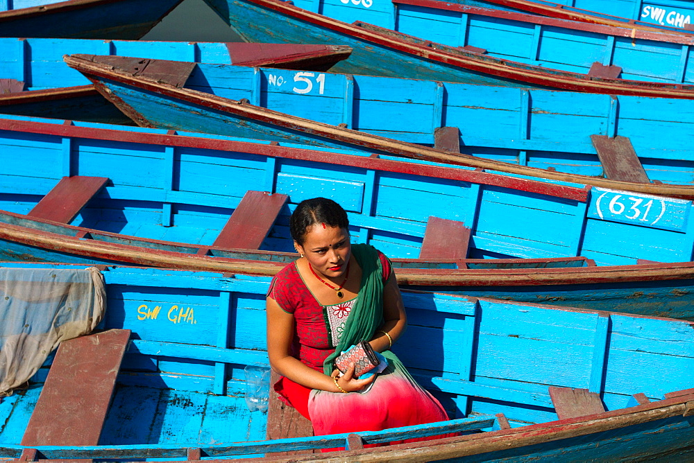Nepalese woman and boats of Phewa Lake, Pokhara, Nepal, Asia