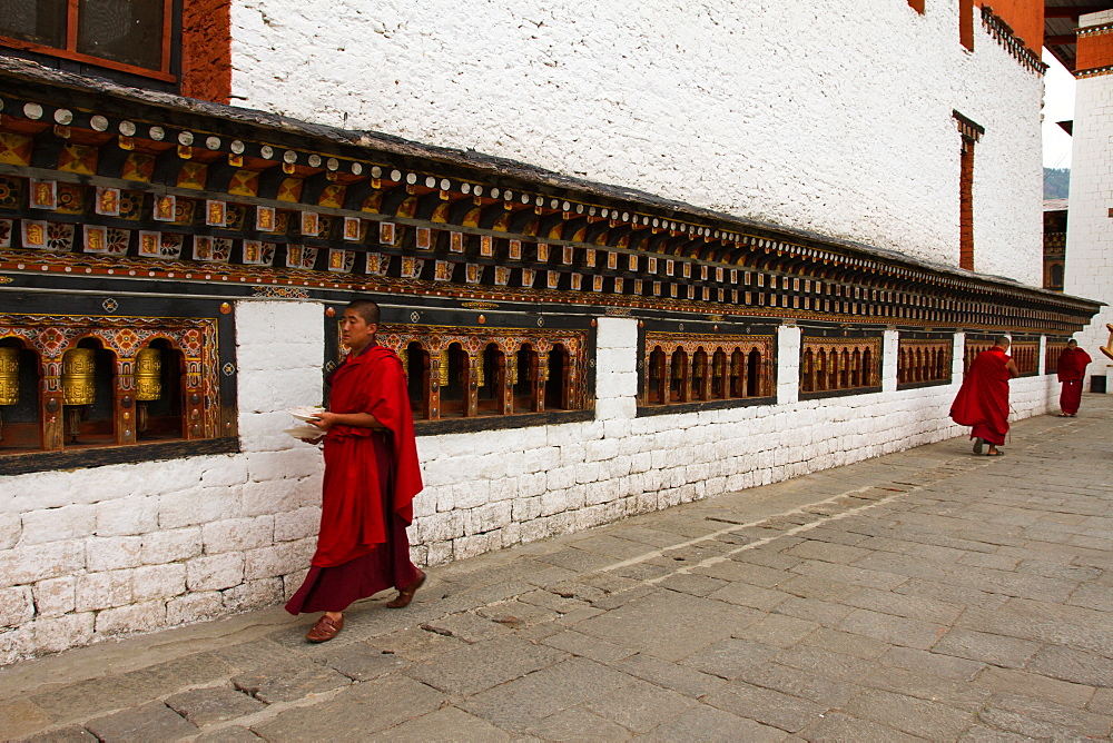 Monks and prayer wheels, Tashi Chho Dzong Fortress, Thimpu, Bhutan, Asia