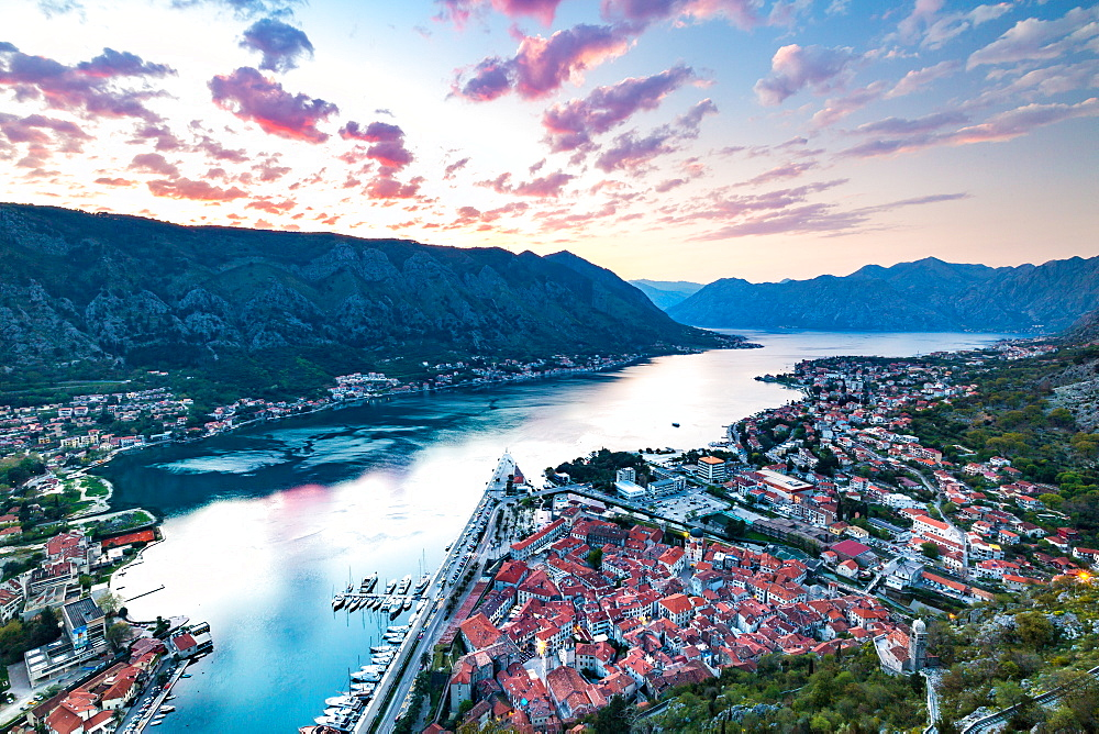 Looking over the Old Town of Kotor and across the Bay of Kotor viewed from the fortress at sunset, UNESCO World Heritage Site, Montenegro, Europe