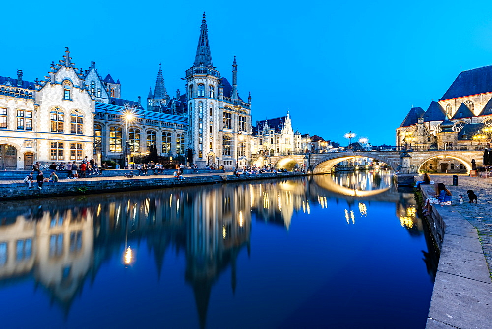 Graslei Quay in the historic city center of Ghent, mirrored in the River Lys during blue hour, Ghent, Belgium, Europe