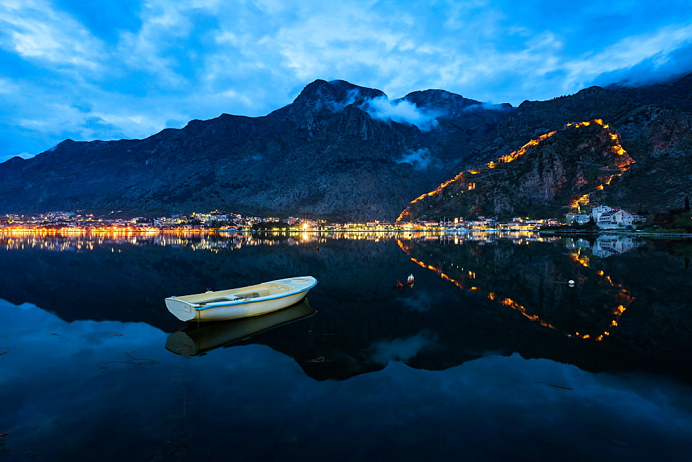 The Old Town (stari grad) and fortress of Kotor reflected in Kotor Bay, UNESCO World Heritage Site, Montenegro, Europe - 1263-20