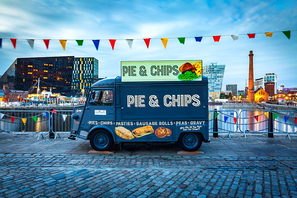 A Pie & Chips food van at the Albert Dock site on the River Mersey waterfront during the evening twilight (blue hour), Liverpool, Merseyside, England, United Kingdom, Europe.