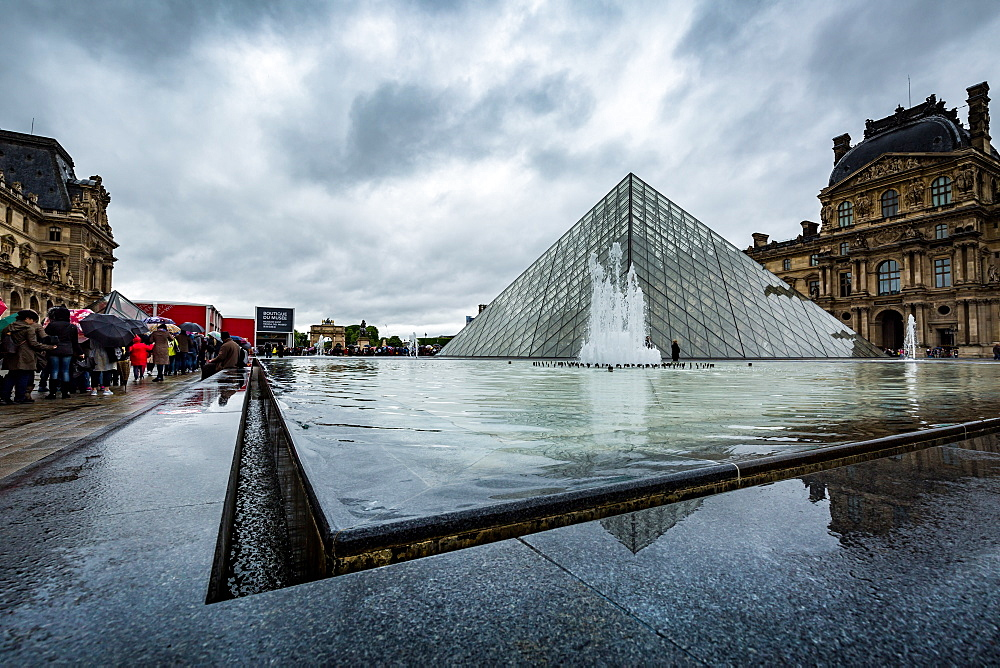 The large pyramid sits in the main courtyard and is the main entrance to the Louvre Museum. Paris, France.