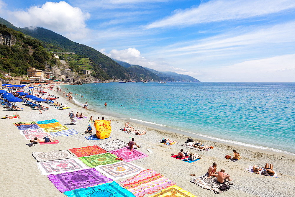 Blanket sellers showcasing their products on the beach at Monterosso, Cinque Terre, Liguria, Italy, Mediterranean, Europe - 1263-86